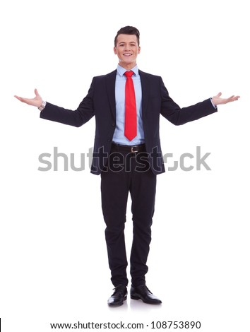Approachable young business man with open arms , welcoming you on white background - stock photo