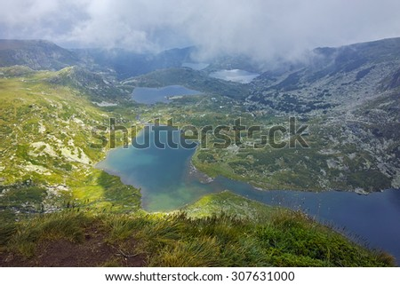 approaching clouds over The Twin, The Trefoil, the Fish and The Lower Lakes, The Seven Rila Lakes, Bulgaria - stock photo