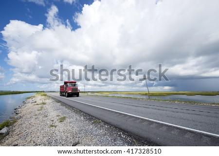 Approaching Grand Isle Louisiana on Highway One - stock photo