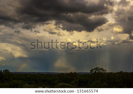 Approaching storm and rainbow Perth Western Australia - stock photo