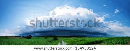 Approaching storm with shelf cloud - stock photo