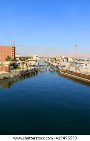 Approaching the Ship locks in Esna, and old dam on the Nile River, Egypt - stock photo
