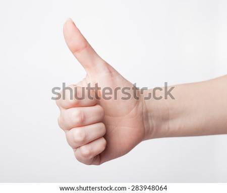 Approval thumbs up like sign as  hand gesture isolated over white background - stock photo