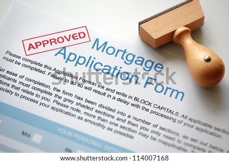 Approved Mortgage loan application with rubber stamp - stock photo