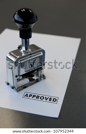 approved stamp in a paper - stock photo