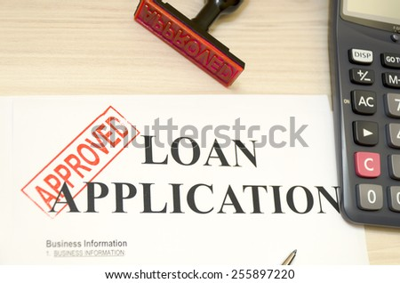 Approved the loan application, approved seal was shot - stock photo