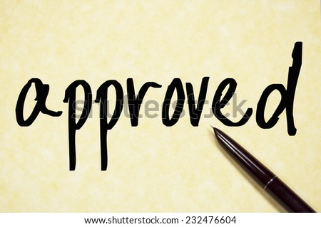 approved word write on paper  - stock photo