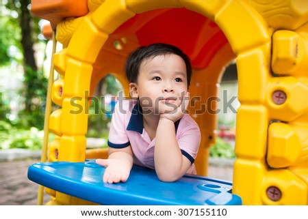 appy laughing cute little three years old asian child boy or kid playing on a playground. Healthy lifestyles concept. - stock photo