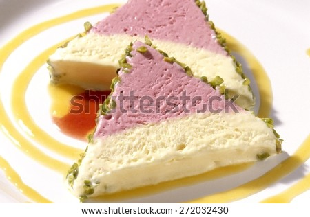 Apricot and Raspberry Parfait Triangles on White Plate - stock photo