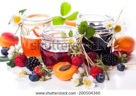 Apricot ,blackberry and strawberry jam on white background. - stock photo