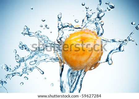 Apricot in spray of water. Juicy peach with splash on white background