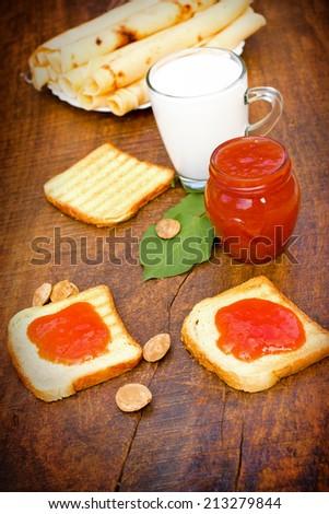 Apricot jam and pancakes - stock photo