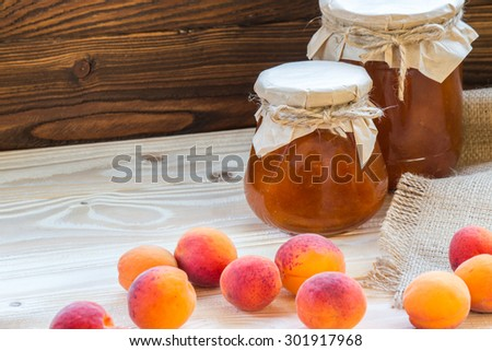apricot jam on wooden table - stock photo