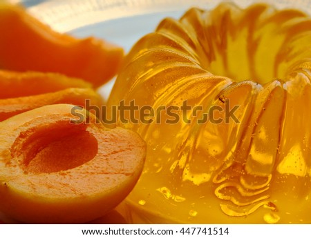apricot jelly with slices of apricots