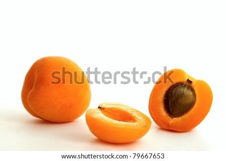 Apricot on white ground - stock photo