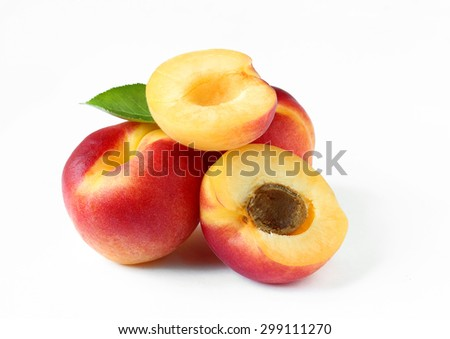 Apricots close up isolated on white - stock photo
