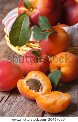 apricots close-up on a background of a basket of fruit on the table. vertical  - stock photo