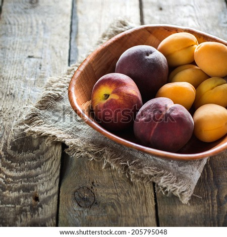 Apricots on a wood table - stock photo