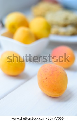 Apricots on a wooden table