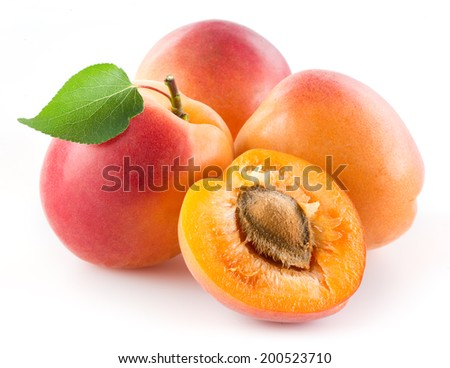 Apricots with leaf isolated on white - stock photo