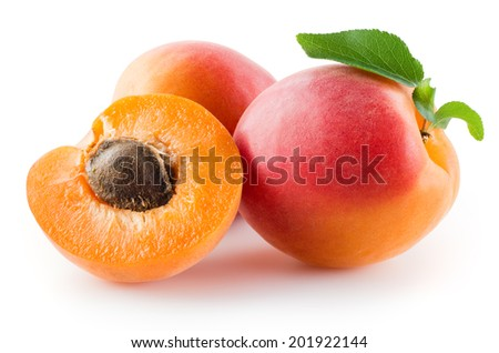 Apricots with leaves on a white background. - stock photo