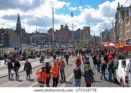 APRIL 27: Amsterdam at the Damrak during the celebration of kings day, april 27, 2015 in Amsterdam, The Netherlands - stock photo
