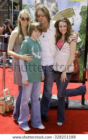 "April 30, 2006. Billy Ray Cyrus and daughter Destiny attend the Los Angeles Premiere of DreamWorks' new computer-animated comedy ""Over The Hedge"" held at the Mann Village Theatre in Westwood, USA. - stock photo"