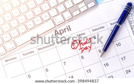 April 1, business calendar with the text: Fools' Day. April 1 st, business calendar, sales plan and business documents, work desk in the office
