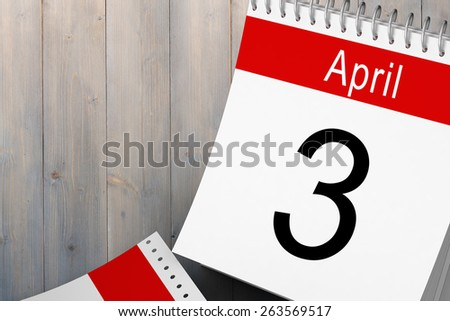 April calendar against pale grey wooden planks