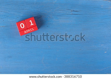 April 1, Cube calendar on wooden surface with copy space - stock photo