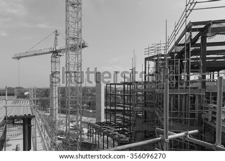 April 2015 - Dorchester, England: A construction site with concrete slabs built, steel framing and scaffolding