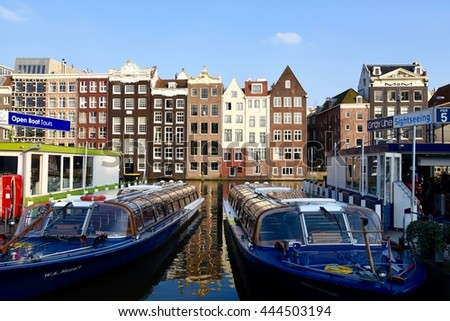 April 14, 2016. Holland, Amsterdam canals.Cruise boats in the canal. - stock photo