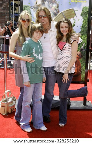 "April 30, 2006. Miley Cyrus and Billy Ray Cyrus at the Los Angeles Premiere of DreamWorks' new computer-animated comedy ""Over The Hedge"" held at the Mann Village Theatre in Westwood, USA. - stock photo"