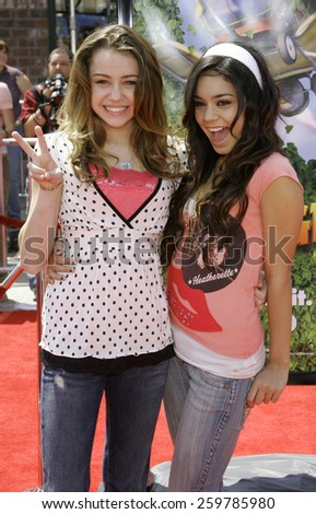 "April 30, 2006. Miley Cyrus and Vanessa Hudgens at the Los Angeles Premiere of DreamWorks' ""Over The Hedge"" held at the Mann Village Theatre in Westwood, California United States.  - stock photo"