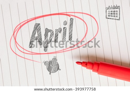 April month memo note with a red circle - stock photo
