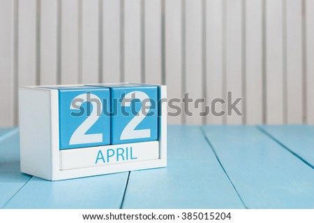 April 22nd. Earth Day. Image of april 22 wooden color calendar on white background.  Spring day, empty space for text - stock photo