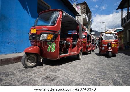 April 6,2016, San Pedro la Laguna,Guatemala: tuktuks lining up waiting for customers beside the local market very popular as a low budget transportation  - stock photo