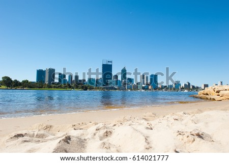 April 2, 2017: Scenic skyline of Perth, capital of Western Australia at the Swan River, seen from a sandy beach at the South Perth shore.
