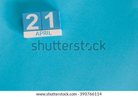 April 21st. Image of april 21 wooden color calendar on blue background.  Spring day, empty space for text - stock photo