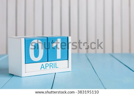 April 1st. Image of april 1 wooden color calendar on white background.  Spring day, empty space for text. All Fool's Day - stock photo
