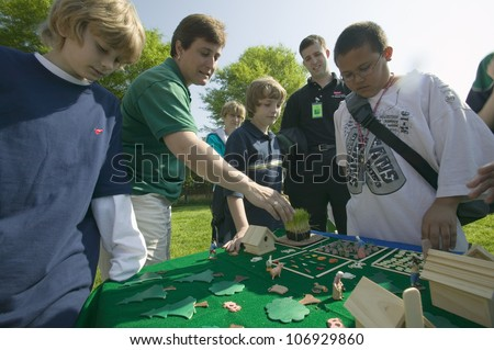"""APRIL 2006 - """"Students of """"Earth Force"""" build simulated village and farming community during Earth Day event in Alexandria, Virginia"""" - stock photo"""