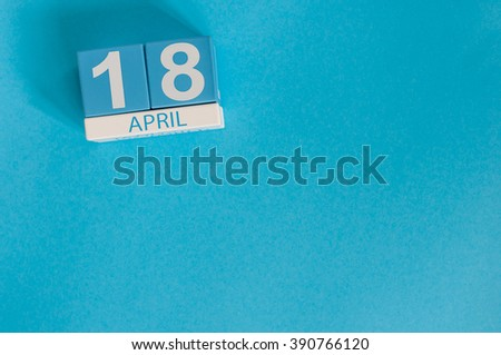 April 18th. Image of april 18 wooden color calendar on blue background.  Spring day, empty space for text. International Day For Monuments and Amateur Radio - stock photo