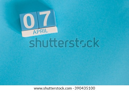 April 7th. Image of april 7 wooden color calendar on blue background.  Spring day, empty space for text. Save the data - stock photo