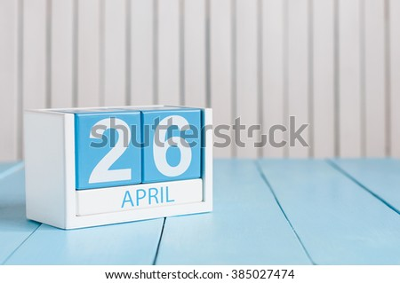 April 26th. Image of april 26 wooden color calendar on white background.  Spring day, empty space for text