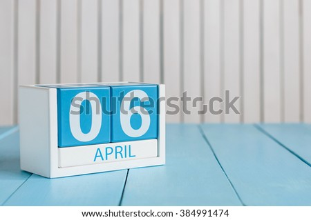 April 6th. Image of april 6 wooden color calendar on white background.  Spring day, empty space for text - stock photo