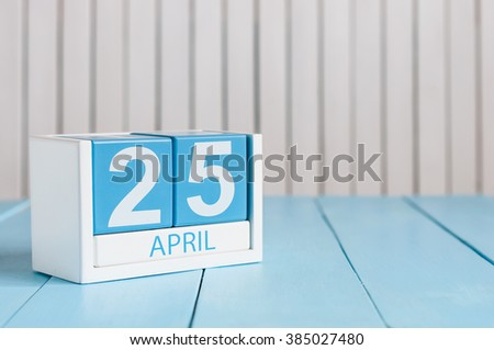 April 25th. International Day Of DNA. Image of april 25 wooden color calendar on white background.  Spring day, empty space for text