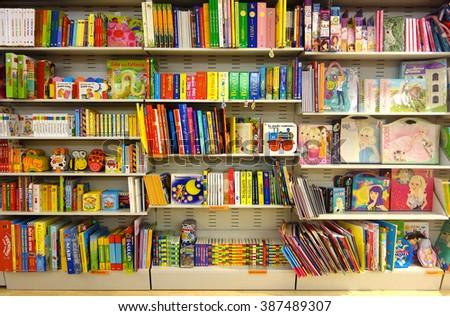 Aprilia, Italy: Circa Aug 2013 - Shelf full of colorful children fairy books  in