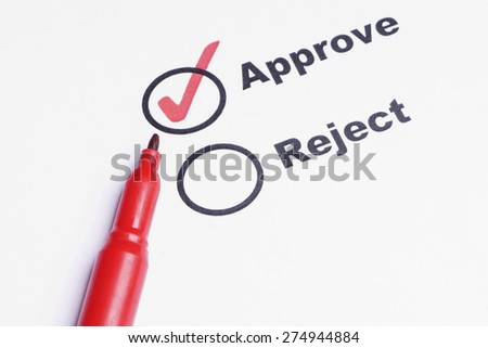 Aprrove and Reject check marks with pen - stock photo