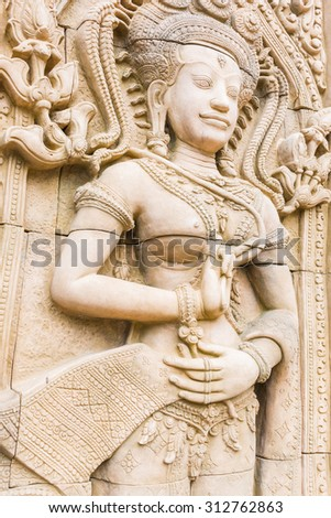 Apsara carvings statue on the wall of Cambodian art