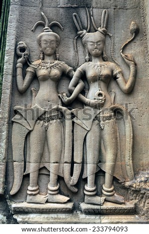 Apsara Dancers Stone Carving all around on the wall at Angkor wat, Siemreap, Cambodia